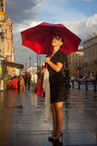 Under red umbrella Royalty Free Stock Images