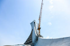 Under repair the Montreal Olympic Stadium tower. It`s the tallest inclined tower in the world.Tour Olympique stands 175 meters tall and at a 45-degree angle Royalty Free Stock Photo