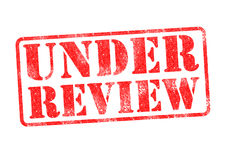 UNDER REVIEW. Red rubber stamp over a white background Royalty Free Stock Photos