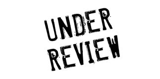 Under Review rubber stamp Stock Images