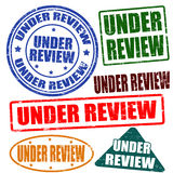 Under review,stamp set Stock Image