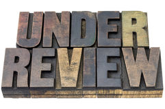 Under review in wood type Royalty Free Stock Image