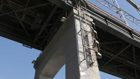 Under River Bridge. Under bridge over the river, middle pan shot stock video