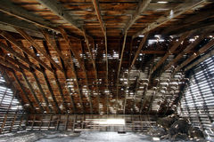 Under the roof. Structure of an old vintage farmhouse roof Stock Photo