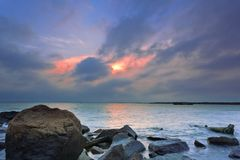 Under the rosy clouds were wooden sailboats and ro Royalty Free Stock Photography