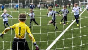 Under 9 years old football cup match. Under 9`s football cup match. Vauxhall Mokkas versus West Kirby Panthers. 10th March 2018 at Ellesmere Port Cheshire royalty free stock photos