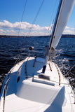 Under sail - starboard tack looking aft from bow. Looking aft from the bow of the boat sailing itself Stock Images