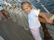 Under the sails. Young girl having rest during The Tall Ships Races in Poland Royalty Free Stock Images