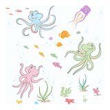Under the sea. The little octopuses play with fish and corals Royalty Free Stock Photography