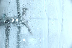 Under the Shower. Water dropping down the glass of a shower Royalty Free Stock Images