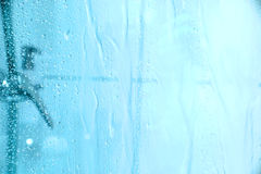 Under the Shower. Water dropping down the glass of a shower Royalty Free Stock Photo