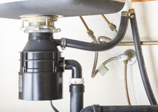 Under the sink. Under the sink garbage disposal unit stock image
