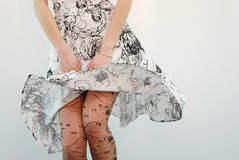 Under skirt. Close up of female legs under skirt Stock Photos