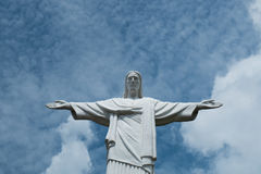 Under the sky. Christ the Redeemer sculpture in spring day Royalty Free Stock Image