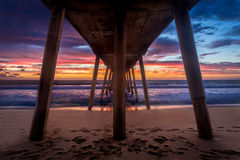 Under the Southern California Pier at Sunset royalty free stock images