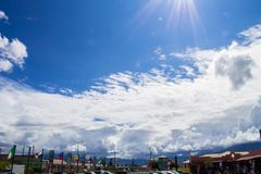 Fantastic sky through the clouds over a tourist square. royalty free stock photos