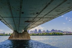 Under steel bridge across river leading to downtown Montreal, Quebec, Canada. MONTREAL, CANADA - JUNE 15, 2018: The Concordia Bridge links the southern point of stock image