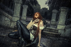 Under the storm, beautiful vampire woman in palace gate, rain Stock Photography