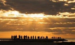 Under the sun. Group of people enjoying the sunset at pirita beach, tallinn Royalty Free Stock Images