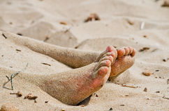 Under the sun two feet out from the hot sand Royalty Free Stock Image