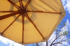 Under a sun umbrella Stock Photos