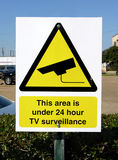 Under Surveillance. Parking lot with camera security Royalty Free Stock Photos