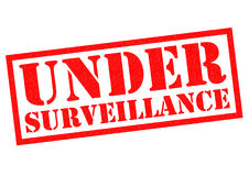 UNDER SURVEILLANCE. Red Rubber Stamp over a white background Stock Images