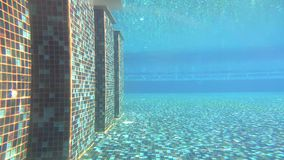 Under swimming pool in hotel with ripple and wave shadow. With underwater camera stock video