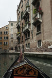 Under the terraces of Venice with a Gondola. From a Trip with a Gondola around Venice, Italy stock photo