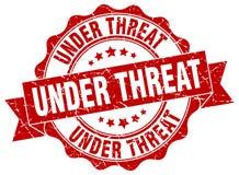 Under threat stamp Stock Image