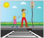 Under traffic lamp. A man, and a girl are about to cross a road. they are waiting under a traffic lamp Stock Images