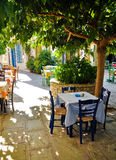 Under tree cafe tables on the village square, Vourliotes, Samos, Royalty Free Stock Photos