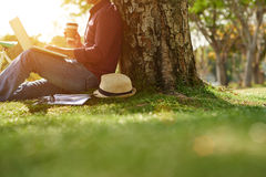 Under tree with laptop stock images