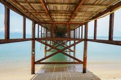 Under tropical pier. At Samui island, Thailand Royalty Free Stock Photos