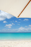 Under Umbrella. View of the Caribbean beach, white sand and crystal blue water, Anguilla Island Royalty Free Stock Photo