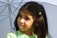 Under an umbrella. Little girl underneath a white umbrella Stock Photography
