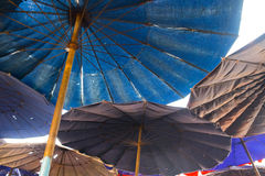 Under umbrella on beach Stock Photos