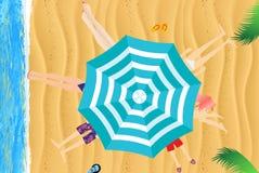 Under an umbrella on the beach Stock Image