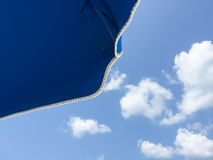 Under umbrella looking at bright blue sky Royalty Free Stock Photography