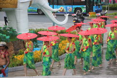 Under the umbrella of the performers in the folk village square shenzhen china Asia Royalty Free Stock Photography