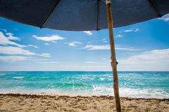 Under the umbrella. Seaside view from under the umbrella Stock Images
