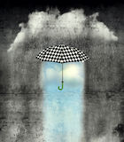 Under the umbrella the weather is wonderful. A surreal image of an umbrella checkered black and white, where below it there is good weather and bad weather with Stock Images