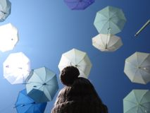 Under the Umbrellas. A girl under the sky full of umbrellas Royalty Free Stock Images