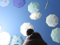 Under the Umbrellas. A girl under the sky full of umbrellas Royalty Free Stock Image