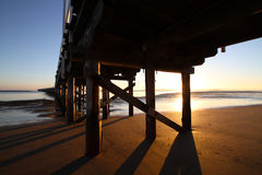 Under Urangan Pier. Hervey Bay, Queensland, Australia at Sunrise Royalty Free Stock Photos