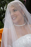 Under Veil. A bride under her white veil before church Royalty Free Stock Image