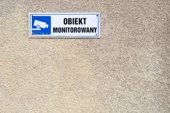 under video surveillance text in Polish, blue CCTV symbol on the stock photography