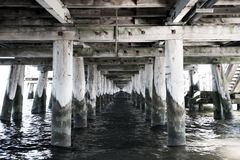 Under view on briwge and water. Under view on wooden construction of wood bridge with water outdoor as natural background with nobody, black and white Stock Image