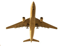 Under view of passenger jet plane prepare for landing on airport Royalty Free Stock Photography