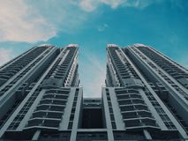 Under View of White Paint High Rise Building during Daytime Royalty Free Stock Photo